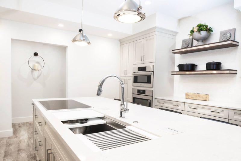 Anything But Vanilla 2 classy modern kitchen with Galley Workstation kitchen sink and induction cooking
