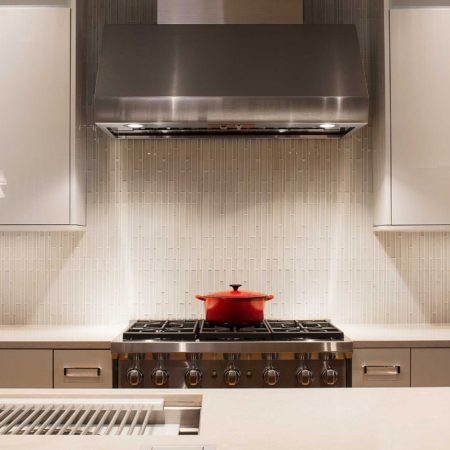 Chrome and Cream 11 beautiful and functional kitchen with vented gas range cooking