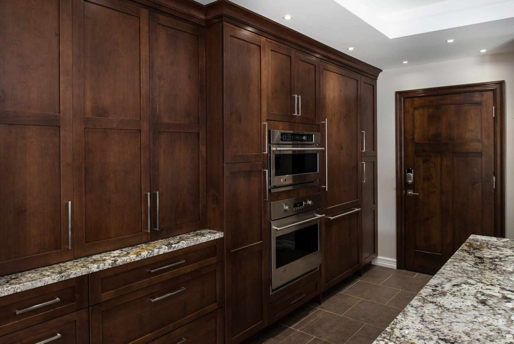Dark Industrial 6 Handsome and rich kitchen with tall pantry storage and double ovens