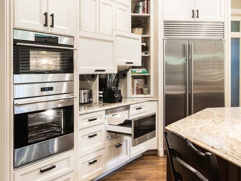 Marble & Wood 3 old world kitchen with pullout Wolf drawer microwave appliance, coffee center and double ovens