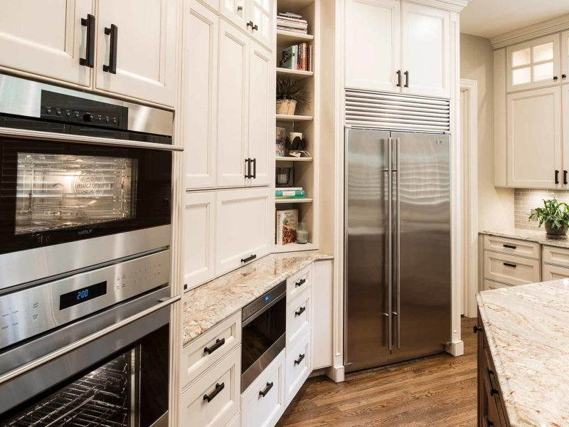 Marble & Wood 4 old world kitchen with pullout Wolf drawer microwave appliance, coffee center and double ovens
