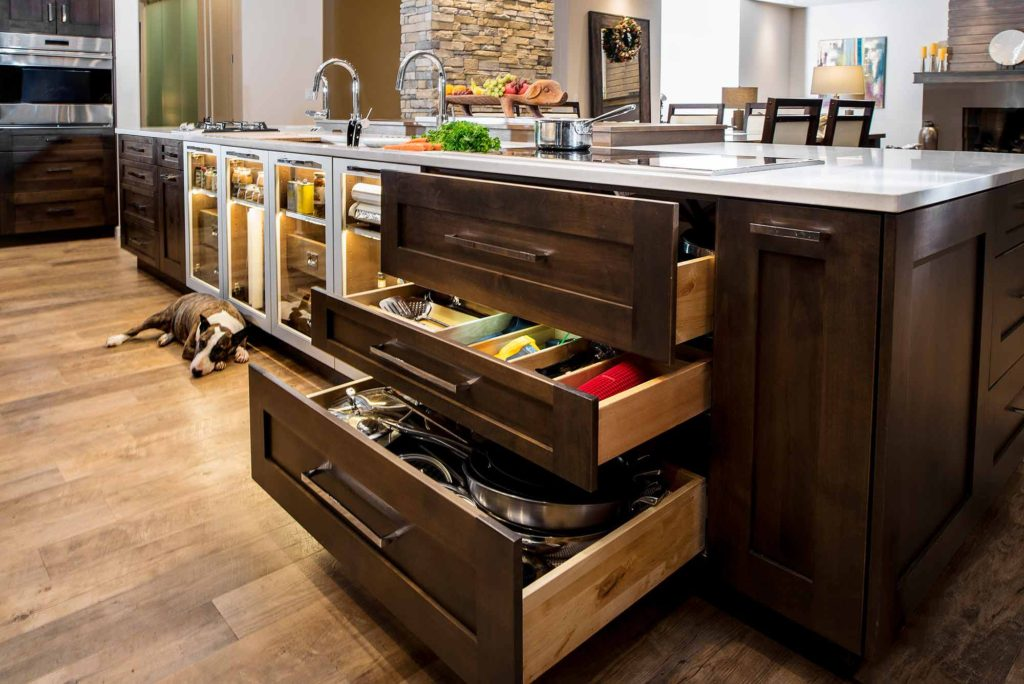 Heart of the Treehouse 11 modern kitchen with pullout storage below the induction cooktop on the island