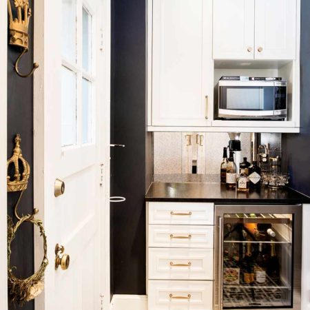 Historically Classy 11 beautiful kitchen with beverage center featuring a mirror backsplash microwave and undercounter refrigerator