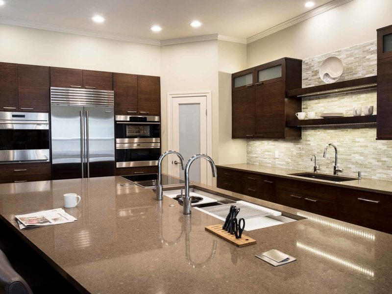 Walnut Galley 1 contemporary kitchen with Galley Workstation kitchen sink and induction cooking