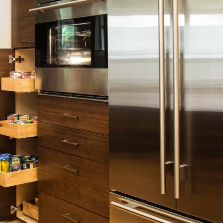 Walnut Galley 5 contemporary kitchen with tall pantry pullout storage, refrigerator and ovens