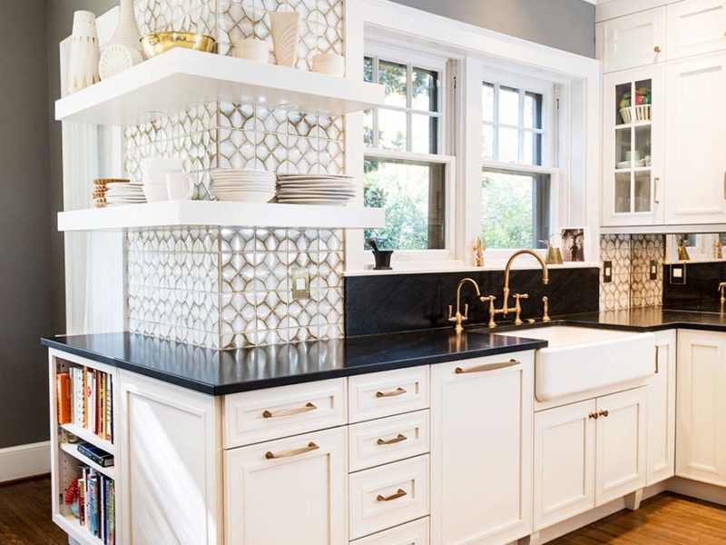 Beautiful midtown Tulsa kitchen with farmhouse cleanup kitchen sink, Ann Sacks Nottingham tile backsplash, open shelving and maple cabinets with melted brie painted finish