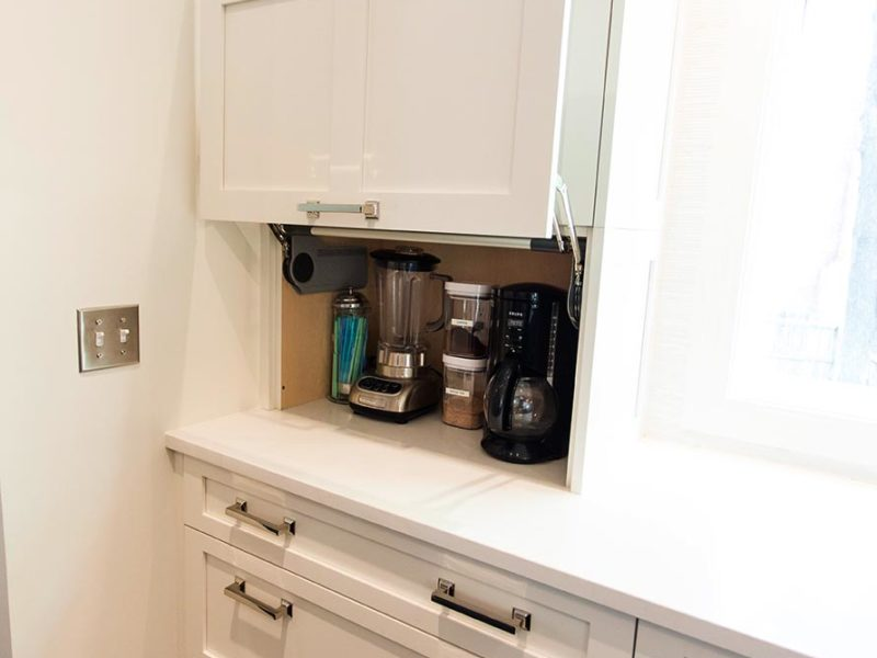 Elegant open Tulsa kitchen remodel with a white cabinet coffee and beverage with storage space and quartz counter top