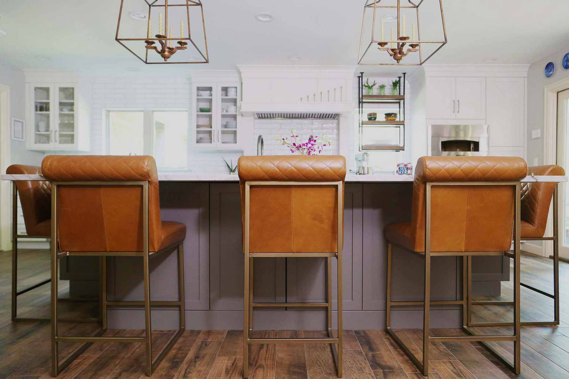 Kitchen design and remodel Tulsa spacious Tulsa kitchen with large island stylish leather seating decorative island pendant lights