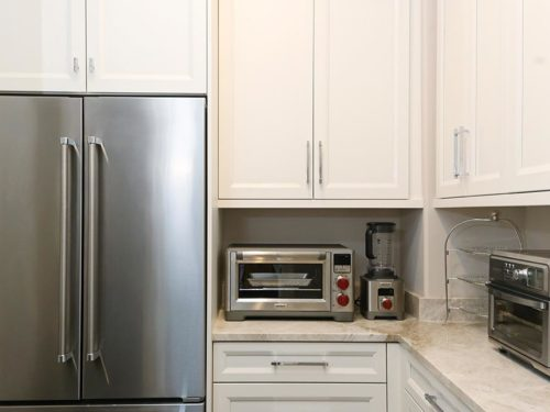 Kitchen design ideas modern kitchen remodel Tulsa kitchen walk-in pantry space with stainless refrigerator and freezer, wall cabinet storage and counter-top toaster oven space