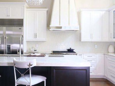 kitchen design modern Tulsa kitchen remodel with decorative vent hood, Wolf professional gas range, full size side-by-side freezer and refrigerator and tile backsplash