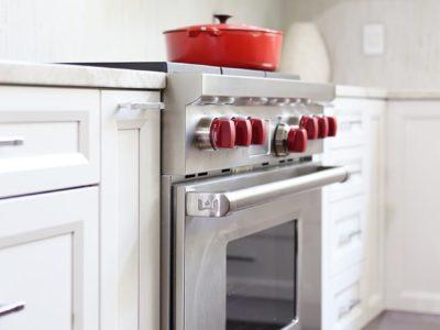 Kitchen design Tulsa modern kitchen remodel kitchen cabinet ideas base pull out storage, Wolf professional gas range, decorative tile backsplash and wall cabinet storage with glass inserts