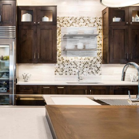 Modern south Tulsa kitchen with Galley Workstation kitchen sinks, open shelves decorative tile backsplash, Sub-Zero tall refrigerators and brown cabinet storage
