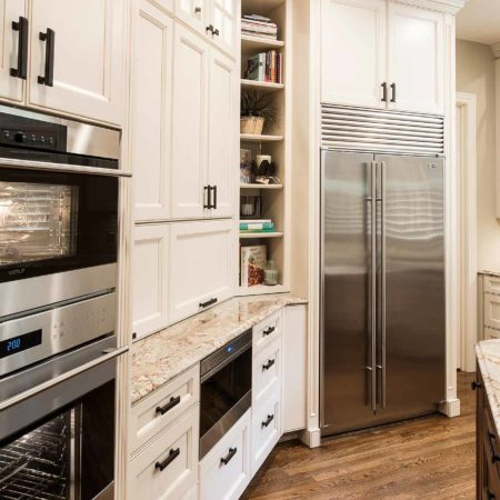 Old world Tulsa kitchen with pull-out Wolf drawer microwave, enclosed coffee center, open shelves, Wolf double ovens and full size freezer/refrigerator