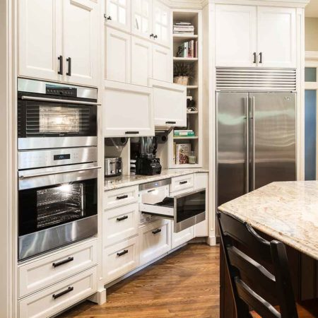 Old world Tulsa kitchen with Wolf drawer microwave, coffee center, double ovens, freezer/refrigerator and storage options throughout.