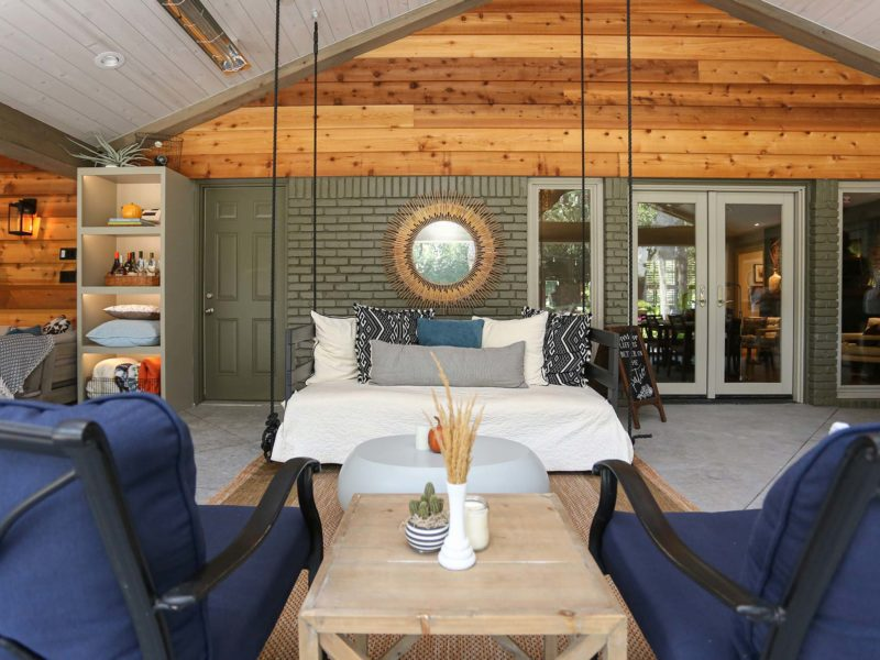 Open spacious Tulsa patio design and remodel living area with concrete flooring and vaulted ceiling