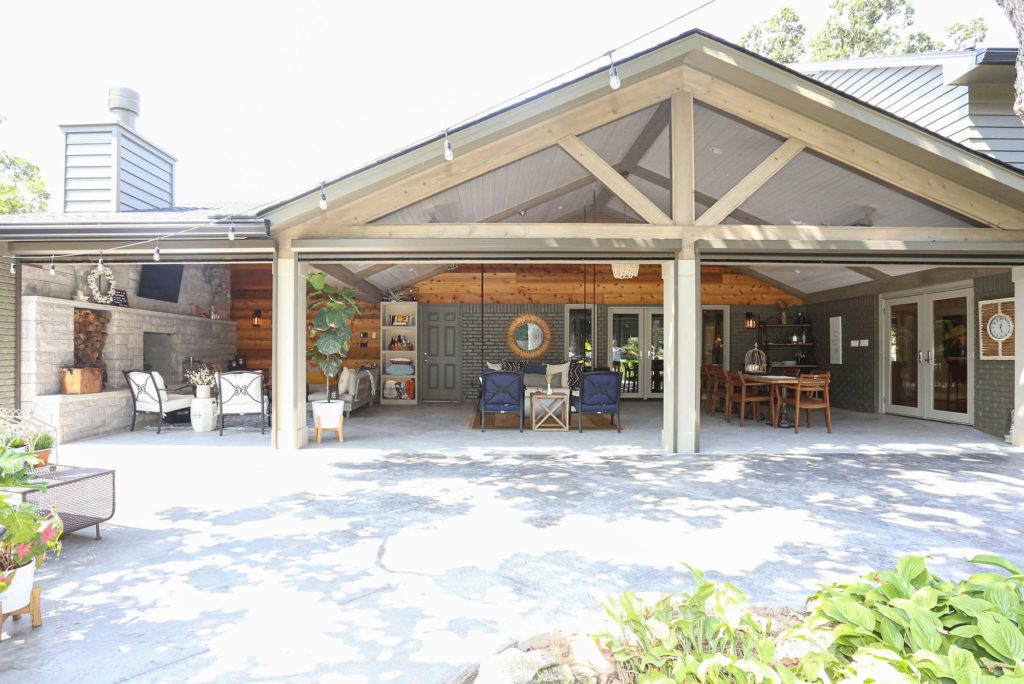 Open Tulsa patio design and remodel including living and dining areas with concrete floor, vaulted ceiling and outdoor furniture