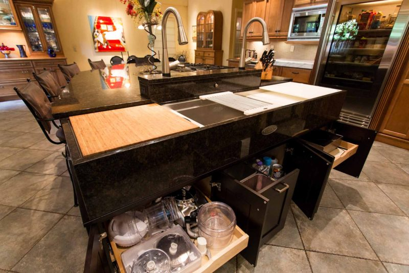 Open classic tuscan style kitchen with storage in island