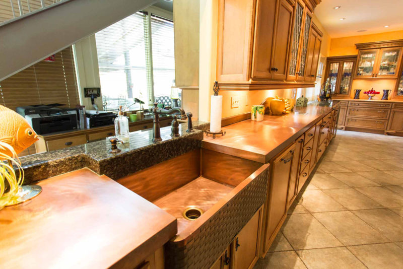 The First Love 5 open classic tuscan style kitchen with copper counter top and farmhouse sink