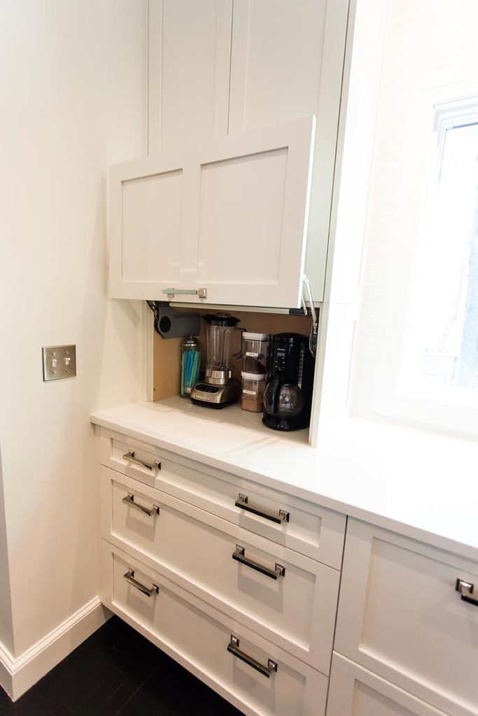 White Done Right 5 elegant open kitchen with concealed coffee and beverage storage