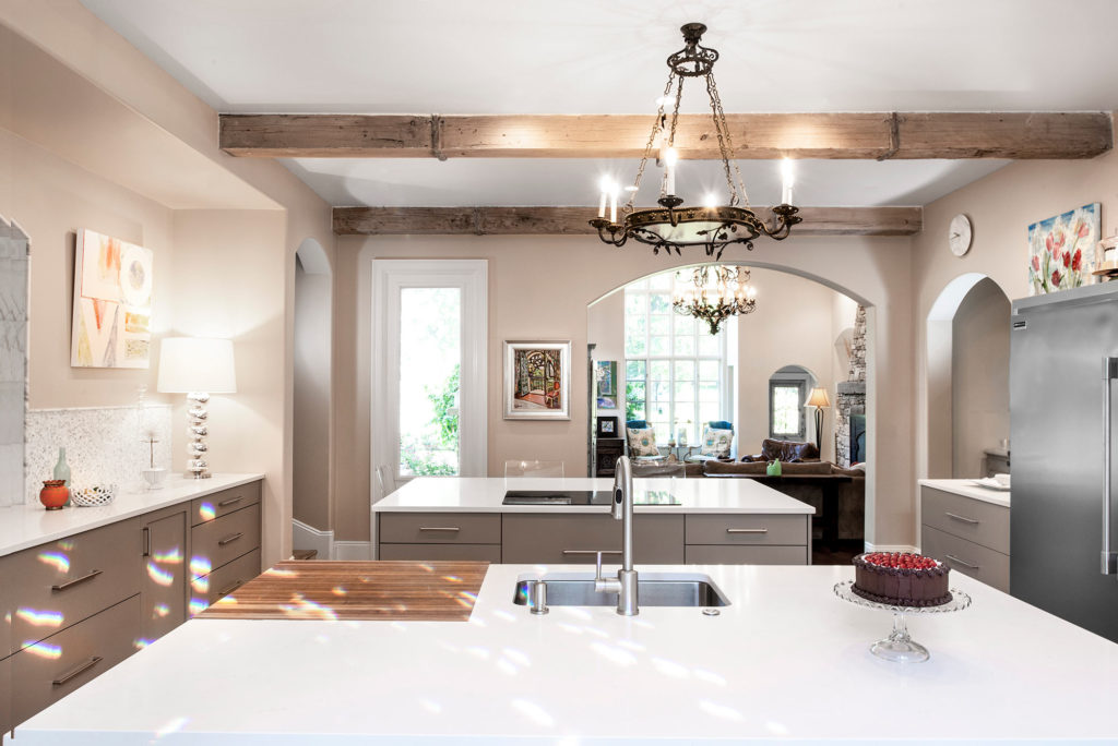 Comfy Tulsa kitchen with two islands featuring induction cooktop and prep sink with counter-top recessed cutting board