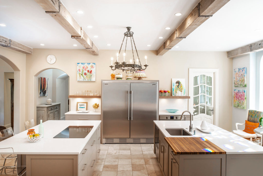 Comfy Tulsa kitchen with two islands featuring induction cooktop and prep sink with counter-top, recessed cutting board and Frigidaire all freezer/refrigerator