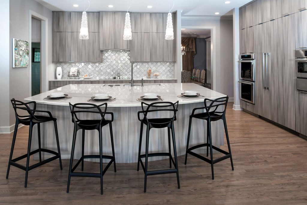 Culinary Elegance 1 warm transitional open kitchen with large island featuring Galley Workstation beautiful Harmoni cabinets, wood floors and stainless appliances