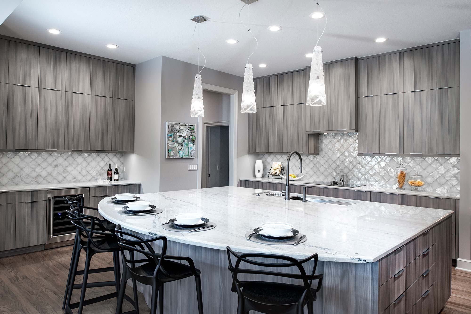 Culinary Elegance 4 warm transitional open kitchen with large island featuring Galley Workstation, beautiful Harmoni cabinets, wood floors and stainless appliances