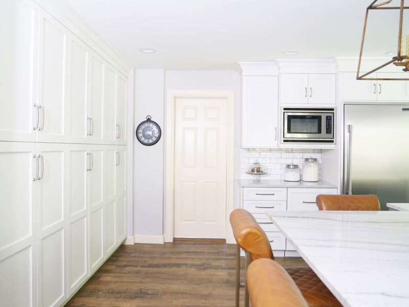 Spacious Tulsa kitchen design and remodel including tall pantry storage, Frigidaire microwave, Sub-Zero stainless refrigerator freezer