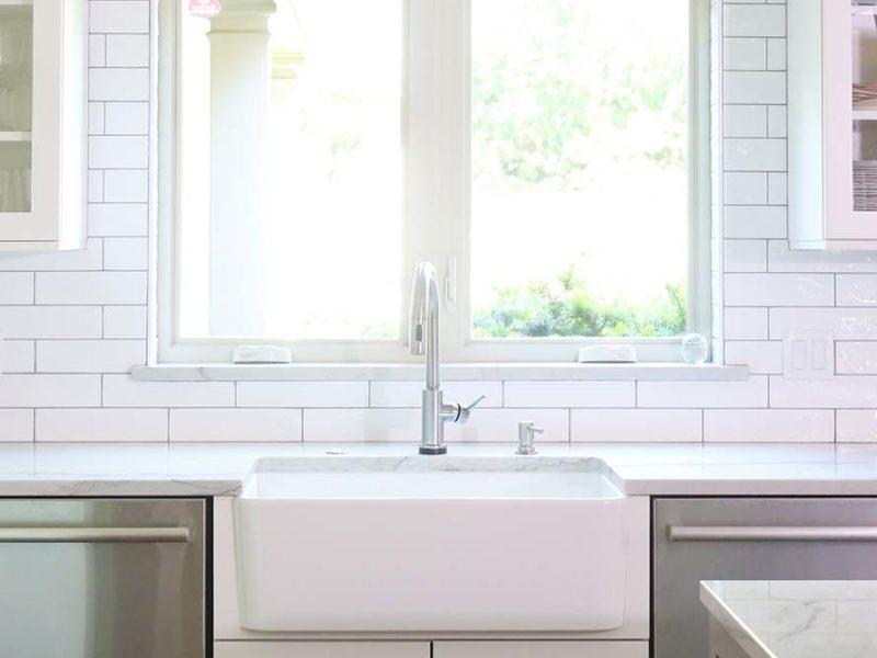 Tulsa kitchen remodelTulsa kitchen remodel designed with and apron-front sink, flanked by stainless dual Monogram dishwashers and white subway tile backsplash.