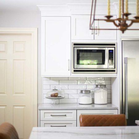 Spacious Tulsa kitchen with Frigidaire wall microwave, drawer refrigerator and subway tile backsplash