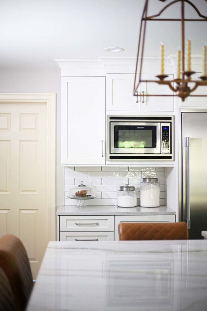 Spacious Tulsa kitchen with Frigidaire wall microwave, drawer refrigerator and subway tile backsplash