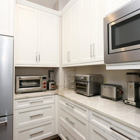 Large Tulsa kitchen including walk-in pantry stainless refrigerator/freezer, wall cabinet storage, counter-top toasters and wall microwave