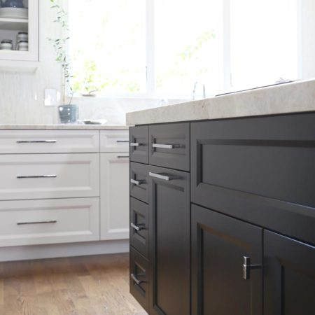 White and rich dark brown base cabinet storage, white counter tops and refinished wood flooring.