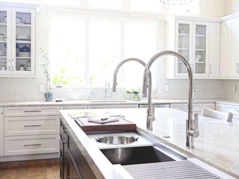 Tulsa kitchen with Galley Workstation, clean-up kitchen sink and glass wall cabinet storage