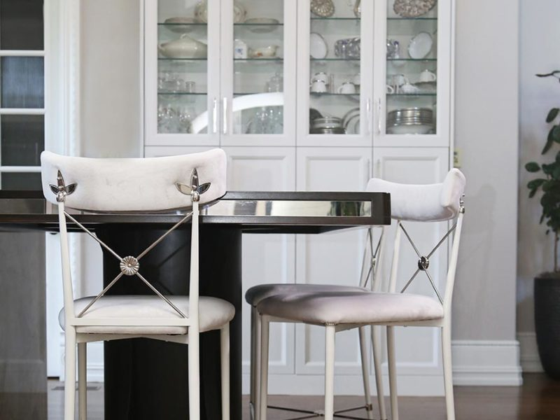 Tulsa kitchen with island table seating and tall white cabinetry pantry housing fine china
