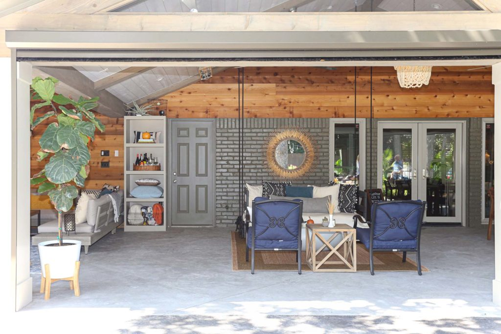 Open spacious Tulsa patio design and remodel with living area including concrete flooring, vaulted ceiling and outdoor furniture